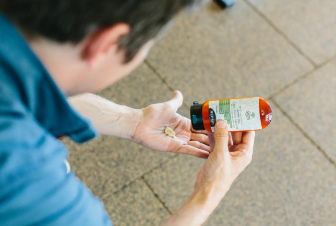 a man holding a CBD lotion