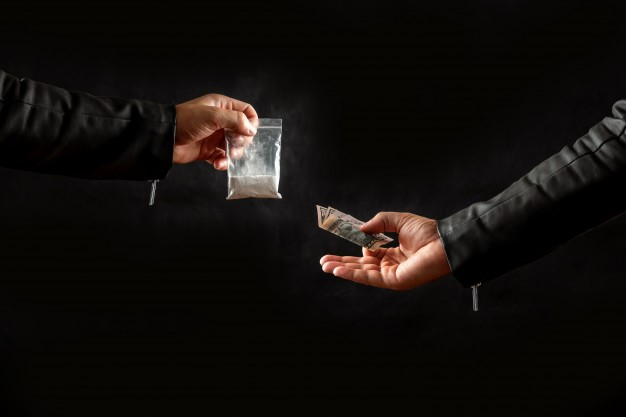 a person buying drugs from a dealer