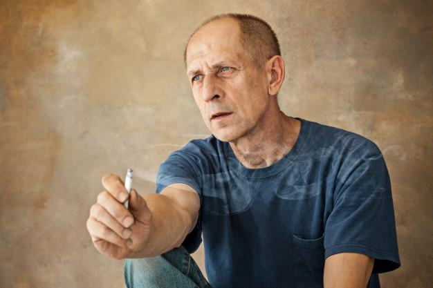 a senior citizen smoking a joint