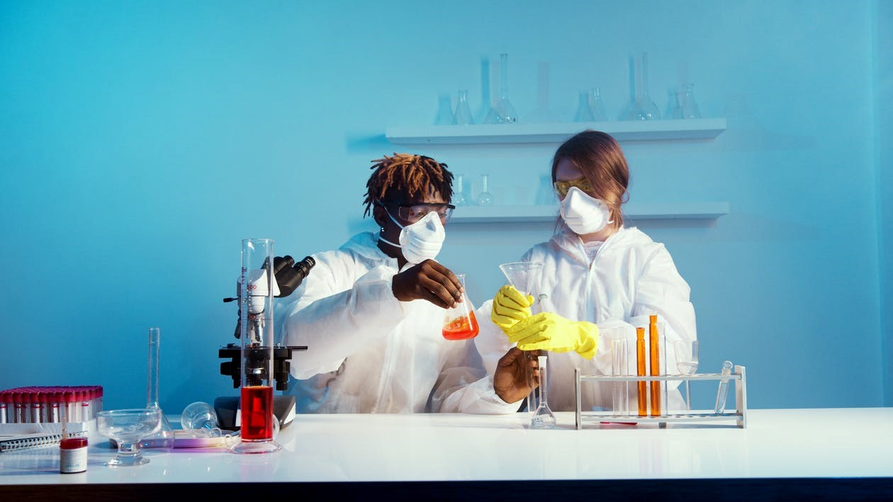 Two medical experts researching in a lab