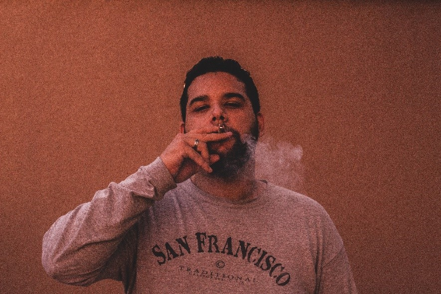 A person smoking a joint