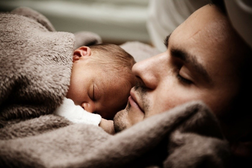 A father sleeping with his child