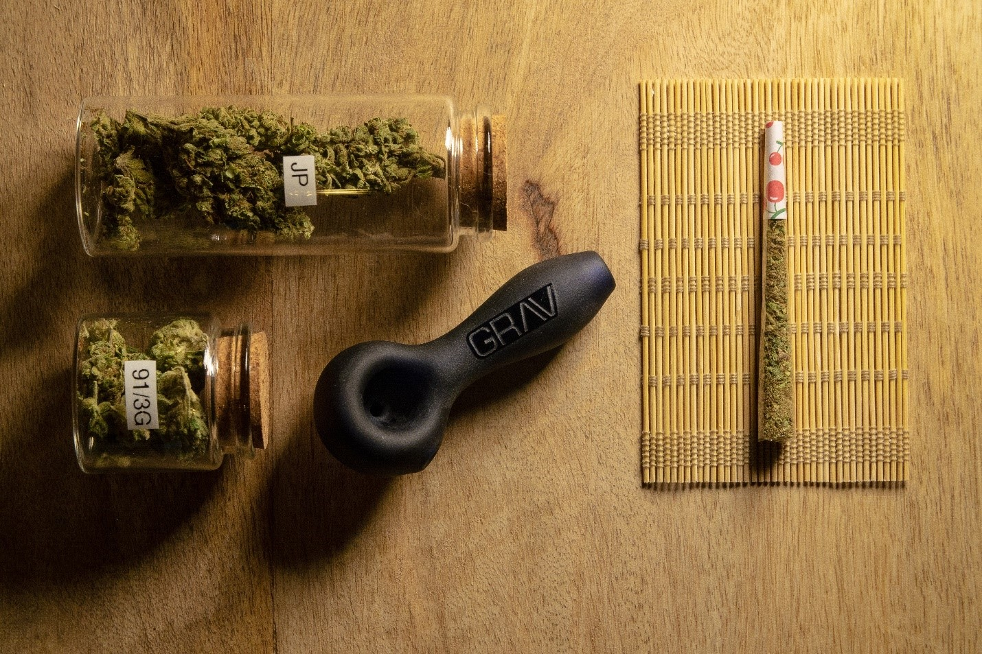 Cannabis stored in jars with a rolled joint